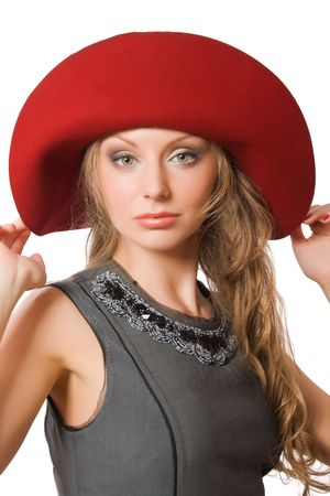 beautiful young female in red hat over white background photo