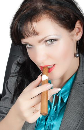 cigar smoking woman: closeup portrait of  sexy brunette smoking cigar isolated