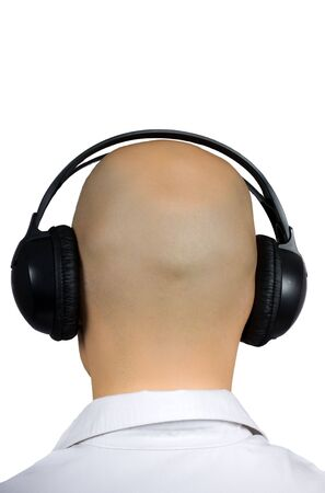 occiput: back of head of bald man with headphones  Stock Photo