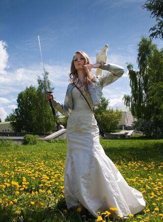 samurai sword: young female with samurai sword and dove Stock Photo