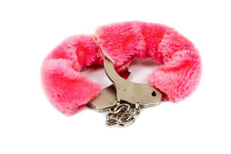 pink fur handcuffs isolated on white photo