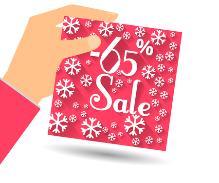 holiday profits: Winter sale. Discount of 65 percent. Hand holds percent discount on the price. Gift card with a winter pattern with snowflakes in a flat style.