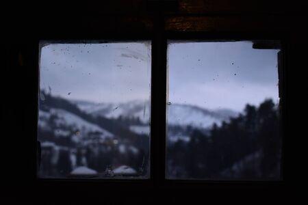View of mountain landscape from window inside Brans castle in Bran Stock Photo