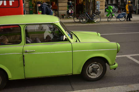 Green vintage Trabant 601 parked on the street in Mitte Berlin