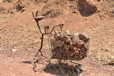 metal animal pushing a cart of war rubble in northern Israel