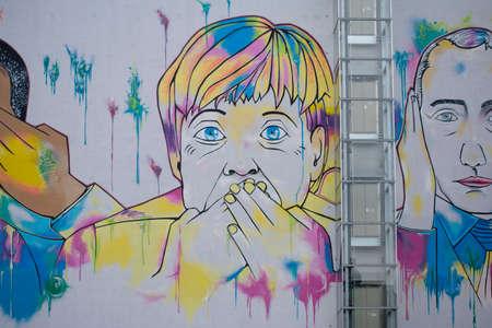 Colorful graffiti of Angela Merkel on a wall in Friedrichshain Berlin