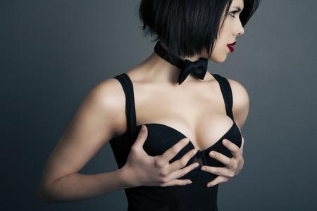 big breast woman: portrait of a beautiful elegant woman in lingerie on a dark background