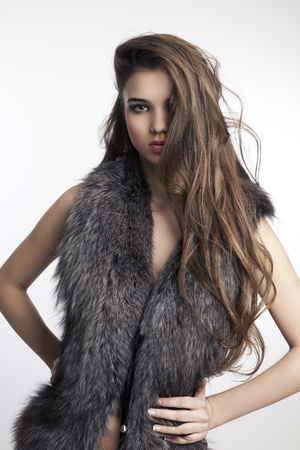 portrait of a beautiful woman wearing fur photo