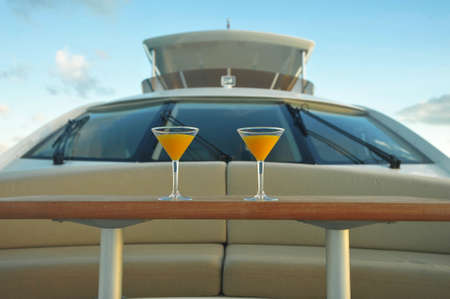 Cocktails on a motor yacht Stock Photo