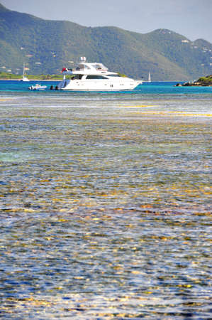 Shallow flats with motor yacht