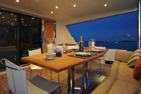 Motor yachts aft deck at night Editorial