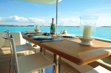 Motor yacht aft deck with dining Stock Photo