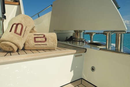 Motor yacht swim deck with towels Stock Photo