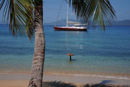 willy: Yacht anchored of a tropical beach Stock Photo