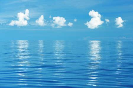 Clouds over calm sea Stock Photo