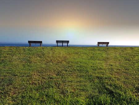 Three bench seats on the horizon