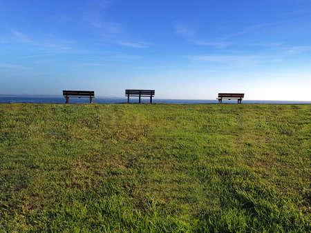 Three benches on the horizon 写真素材