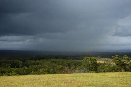 Rain moving across a rural landscape