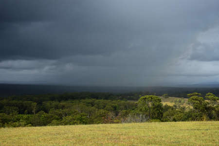 Rain moving across a rural landscape
