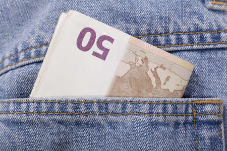 euros in the pocket of the jeans