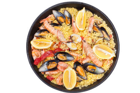 Paella, Spanish dish with mussels and different types of seafood photo
