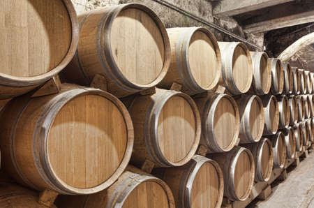 Valladolid, Spain, July 9th, 2011. Inside a winery in Ribera del Duero, with wine barrels stacked