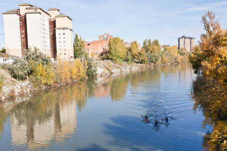 Valladolid, Spain, November 12, 2011. Pisuerga river passing through the city of Valladolid, with several kayakers Stock Photo - 11594084