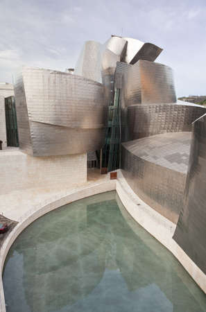 january 1: Bilbao, Spain, January 1, 2012. Artificial lake side of the Guggenheim Museum of Contemporary Art, designed by architect Frank O. Gehry, the building surrounded by titanium plates