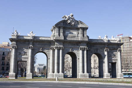 Madrid, Spain, February 12th, 2012. Puerta de Alcala, built by Charles III and designed by Francisco Sabatini was one of five entry doors to real Madrid. It is the first triumphal arch built in Europe.