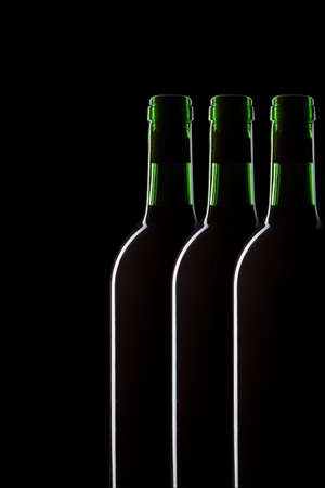Bottles of wine with the edge-lit black background photo