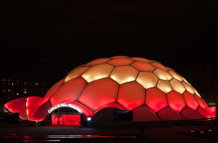 ruiz: Valladolid, Spain - April 28, 2012: Cupula del Milenio (Millennium Dome) at night, with the colors of the Spanish flag.. The dome design allows to change color by lighting. This building was built by the architect Enric Ruiz Geli for Expo Zaragoza 2008. Editorial