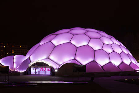 ruiz: Cupula del Milenio (Millennium Dome) at night,  The dome design allows to change color by lighting. This building was built by the architect Enric Ruiz Geli for Expo Zaragoza 2008.