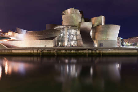 Bilbao, Spain - June 17, 2012: Guggenheim Museum Bilbao is a museum of modern and contemporary art designed by Canadian architect Frank Gehry-American in 1997, located in Bilbao, Basque Country, Spain, with its reflections on the river Nervi?. It is a nig