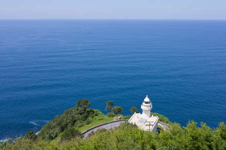 cantabrian: Lighthouse on the bay of La Concha in San Sebastian, Spain Stock Photo