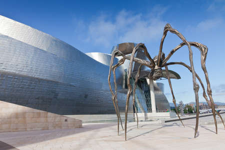 Bilbao, Spain, June 16,2012: Bronze sculpture, steel and marble, seen from below, and located at the rear of the Guggenheim Museum Bilbao, Spain. It is the most visited tourist site Editorial