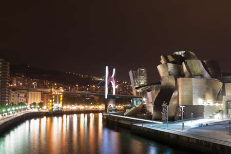 Bilbao, Spain - June 17, 2012: Guggenheim Museum Bilbao is a museum of modern and contemporary art designed by Canadian architect Frank Gehry-American in 1997, located in Bilbao, Basque Country, Spain, with its reflections on the river Nervi?. It is a  Editorial
