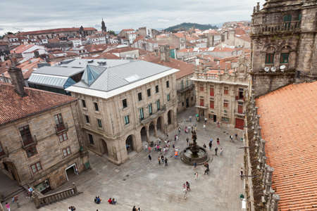 plater: Santiago de Compostela, Spain - August 4, 2012: Plaza de Las Plater?, attached to the south side of the Cathedral, with the power of the horses work of J. Pernas in 1825. There are people walking.