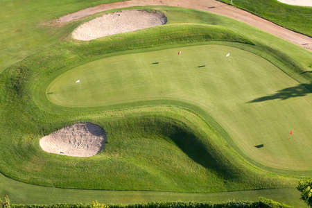 Aerial view of a golf course with sand bunkers Stock Photo