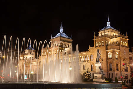 cavalry: Valladolid, Spain - November 23, 2012:  Cavalry Academy at night and the fountain Zorrilla of Valladolid, Spain. The Cavalry Academy is a military school