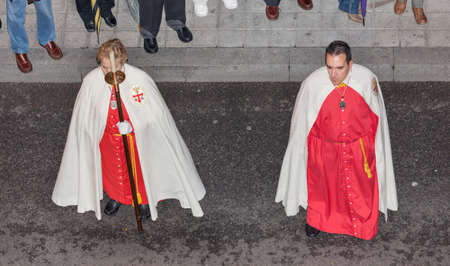 processions: VALLADOLID, SPAIN - APRIL 6: Penitentes general procession during Holy Week in Valladolid, Spain, on April 6, 2012. It is one of the most important night processions in Spain Editorial