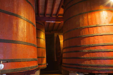 Casks old red wine in a cellar photo