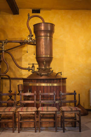 distill: Old alembic  to distill wine Stock Photo