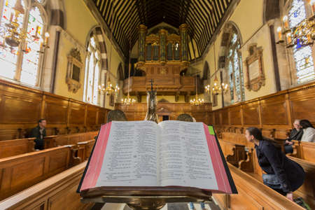 lectern: Oxford, United Kingdom - May 15, 2016: Bible in his lectern in the chapel of Balliol College in Oxford
