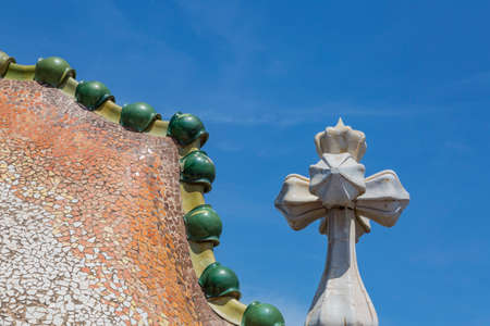 singular architecture: Barcelona, Spain - August 12, 2016; Singular roof of the Casa Batllo, designed by the architect Gaudí