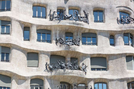 singular architecture: Barcelona, Spain - August 12, 2016; Balcony house La Pedrera of Antoni Gaudi in Barcelona