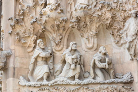 singular architecture: Barcelona, Spain - August 10, 2016; Detail of stone relief of the apostles on the facade of the Basilica of the Sagrada Familia in Barcelona, Spain Editorial