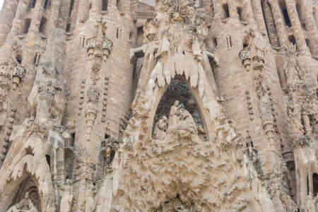 singular architecture: Barcelona, ??Spain - August 10, 2016; Facade of the Passion of BasÃÂcia of the Sagrada Familia in Barcelona Editorial