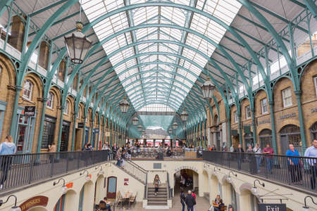 London, UK - May 16, 2016; Market and shops of Covent Garden, with people walking