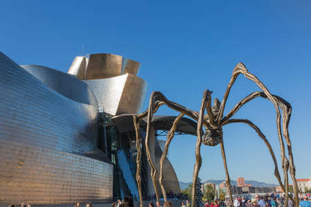 Bilbao, Spain - October 29, 2016; Back of the Gugenheim Museum, contemporary art, work of the Canadian architect Frank O. Gehry, and the sculpture of the spider of Louise Bourgeois Editorial
