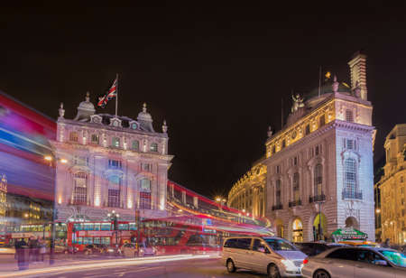 british touring car: London, United Kingdom - Mayo 13, 2016; Traffic in Piccadilly Circus in London, United Kingdom